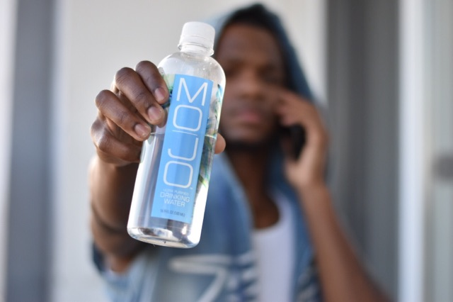 Shawn B Holds Mojo Water